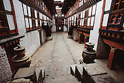 The interior of Jakar Dzong, east central Bhutan. The Dzong?or fortress?is one of many in the country that historically provided sanctuary for the country's people during war and strife. Today they are used as administrative offices for government and housing for Buddhist monks. Architecture. From coverage of revisit to Material World Project family in Bhutan, 2001.