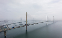 Aerial view of the three bridges crossing Firth of Forth during fog, Scotland, UK