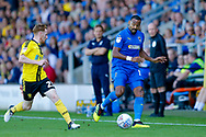 Wimbledon midfielder Liam Trotter (14) in action  during the EFL Sky Bet League 1 match between Burton Albion and AFC Wimbledon at the Pirelli Stadium, Burton upon Trent, England on 1 September 2018.