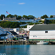 Mackinac Island Harbor With Fort Mackinac In The Background