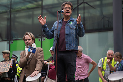 Author, journalist and environmental campaigner George Monbiot addresses activists from Extinction Rebellion, Stop HS2, XR Roads Rebellion and Paid to Pollute outside the Department for Business, Energy and Industrial Strategy (BEIS) following the Stop The Harm march on the fourth day of Impossible Rebellion protests on 26th August 2021 in London, United Kingdom. Extinction Rebellion are calling on the UK government to cease all new fossil fuel investment with immediate effect.