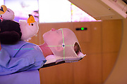 a young boy with medical staff during his final treatment of proton therapy at the Mayo Clinc in Rochester, MN