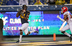 Sep 8, 2018; Morgantown, WV, USA; West Virginia Mountaineers wide receiver Gary Jennings Jr. (12) catches a touchdown pass during the third quarter against the Youngstown State Penguins at Mountaineer Field at Milan Puskar Stadium. Mandatory Credit: Ben Queen-USA TODAY Sports