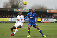 AFC Wimbledon midfielder Jimmy Abdou (8) battles for possession with Blackpool's Dan Agyei (22) during the EFL Sky Bet League 1 match between AFC Wimbledon and Blackpool at the Cherry Red Records Stadium, Kingston, England on 20 January 2018. Photo by Matthew Redman.