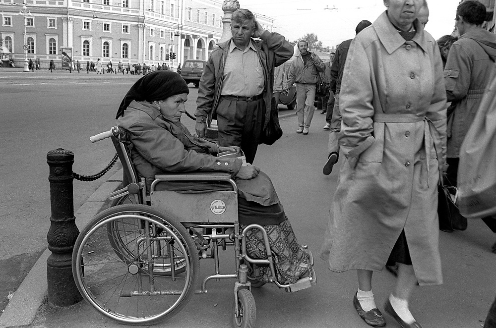 Woman in wheel chair begging on the streets. <br /> St Petersburg, Russia, 1994