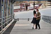 Hamburg, Germany, Jun 06, 2010, Couple dancing tango along the River Elbe. PHOTO © Christophe Vander Eecken