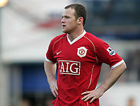 Photo: Lee Earle.<br /> Portsmouth v Manchester United. The Barclays Premiership. 07/04/2007.United's Wayne Rooney looks dejected as they trail to Portsmouth.