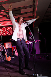 """© Licensed to London News Pictures. 28/09/2014. London, UK. Musical eccentric, John Ottway performs at HMV Oxford Street in London on 28th September 2014 to promote his new film 'Otway The Movie: Rock 'n' Roll's Greatest Failure"""".  John Ottway has been an active musician since 1969, and has maintained a cult following ever since. Photo credit : Vickie Flores/LNP"""