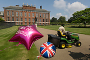 On the day after what would have been the 60th birthday of Princess Diana, a gardener mows the grass outside Kensington Palace on 2nd July 2021 in London, United Kingdom. Diana, Princess of Wales became known as the Peoples Princess following her tragic death, and now as in 1997, many royalists, and mourners came to her royal residence in remembrance and respect.