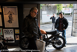 Harley-Davidson head of design Ray Drea (L) with design staff Ben McGinley and Dais Nagao at the Deus Ex Machina new Tokyo store 3-days after its grand opening. Tokyo. Japan. Wednesday, December 10, 2014. Photograph ©2014 Michael Lichter.