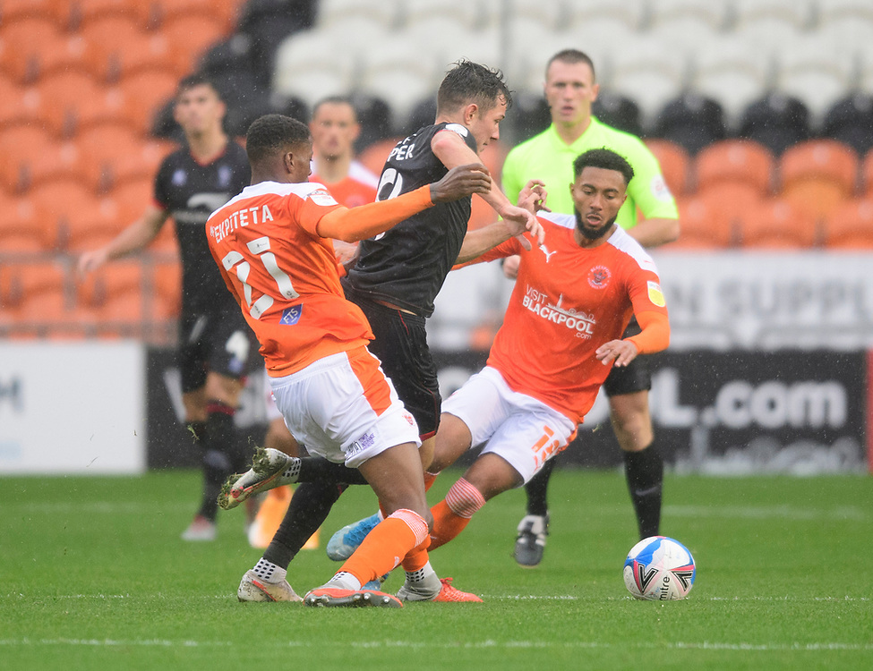 Lincoln City's Tom Hopper gets between Blackpool's Marvin Ekpiteta, left, and Grant Ward<br /> <br /> Photographer Chris Vaughan/CameraSport<br /> <br /> The EFL Sky Bet League One - Blackpool v Lincoln City - Saturday 3rd October 2020 - Bloomfield Road - Blackpool<br /> <br /> World Copyright © 2020 CameraSport. All rights reserved. 43 Linden Ave. Countesthorpe. Leicester. England. LE8 5PG - Tel: +44 (0) 116 277 4147 - admin@camerasport.com - www.camerasport.com