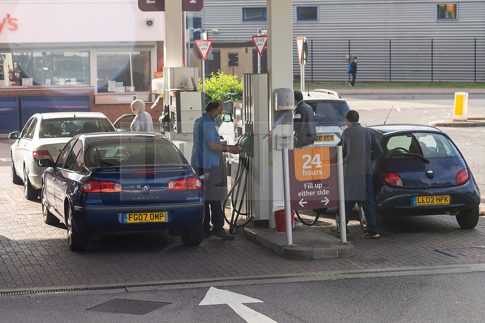 © Licensed to London News Pictures. 24/09/2021. London, UK. Motorists queue to fill up petrol at a Sainsbury's petrol station in Alperton, West London.  Some petrol stations have closed fuel pumps due to the problems with the supply and distribution chain. Companies including BP and Shell have restricted deliveries due to the lack of HGV drivers. Photo credit: Ray Tang/LNP