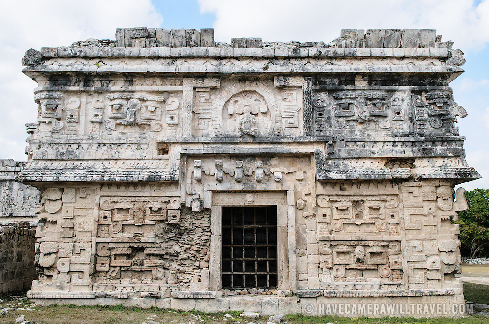 """Intricately decorated buildings at Chichen Itza, a pre-Columbian archeological site in Yucatan, Mexico. This building is known as """"La Iglesia"""" and is in the Las Monjas complex of buildings."""