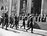 The army passes by the General Post Office during the Easter Sunday Military Parade in Dublin..22.04.1962