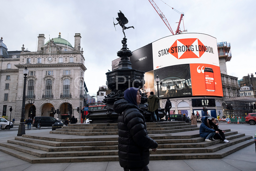 At Piccadilly Circus the giant advertising screens show slogan for London to stay strong as the national coronavirus lockdown three continues on 29th January 2021 in London, United Kingdom. Following the surge in cases over the Winter including a new UK variant of Covid-19, this nationwide lockdown advises all citizens to follow the message to stay at home, protect the NHS and save lives.
