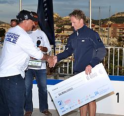 Jesper Radich collects his prize at Match Race France. Photo: Chris Davies/WMRT
