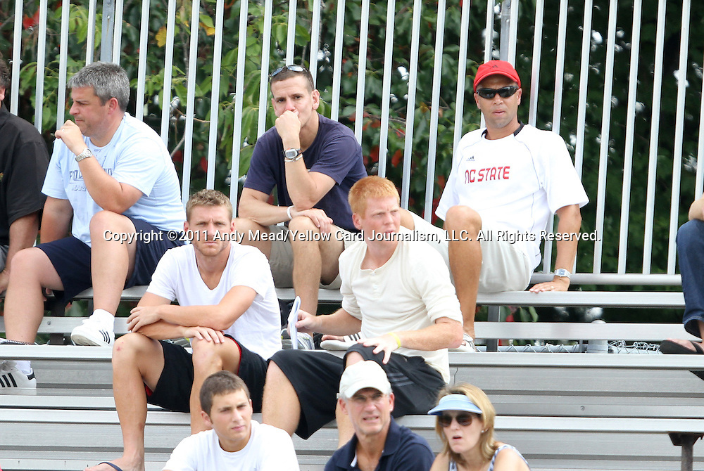 04 September 2011: David Kammarman (center, top row) scouts the game for the Los Angeles Galaxy. Carolina RailHawks players Floyd Franks (middle row, left) and Cory Elenio (middle row, right) also watch the game. The University of California Santa Barbara Broncos defeated the North Carolina State University Wolfpack 1-0 at Koskinen Stadium in Durham, North Carolina in an NCAA Division I Men's Soccer game.