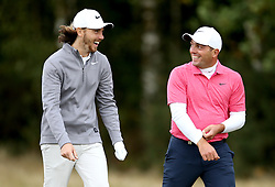 Tommy Fleetwood (left) and Francesco Molinari during day two of the British Masters at Walton Heath Golf Club, Surrey.