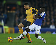 Francis Coquelin of Arsenal challenged by Idrissa Gueye of Everton during the English Premier League match at Goodison Park Stadium, Liverpool. Picture date: December 13th, 2016. Pic Simon Bellis/Sportimage