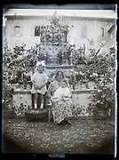 mother with little children by a decorated memorial  altar France 1923