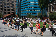 City workers take a break at lunchtime in the now redeveloped area with modern glass offices and angular structures at Aldgate in the City of London, England, United Kingdom. As Londons financial district grows in height, the architecture has changed the face of Londons financial district.