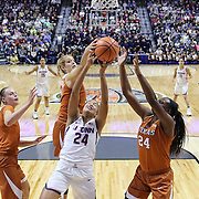 UNCASVILLE, CONNECTICUT- DECEMBER 4: Napheesa Collier #24 of the Connecticut Huskies attempts to rebound while challenged by Kelsey Lang #40 of the Texas Longhorns, Khaleann Caron-Goudreau #30 of the Texas Longhorns and Joyner Holmes #24 of the Texas Longhorns during the UConn Huskies Vs Texas Longhorns, NCAA Women's Basketball game in the Jimmy V Classic on December 4th, 2016 at the Mohegan Sun Arena, Uncasville, Connecticut. (Photo by Tim Clayton/Corbis via Getty Images)