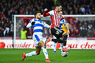 Brentford Forward Said Benrahma (21) and Queens Park Rangers Midfielder Jordan Cousins (8) battle for the ball during the EFL Sky Bet Championship match between Brentford and Queens Park Rangers at Griffin Park, London, England on 2 March 2019.