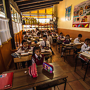 I photographed these kids in a school in Oaxaca city Mexico.