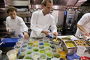 Chef Dan Barber prepares food in the kitchen of his Blue Hills Restaurant in New York City.  (Chef Dan Barber is mentioned in the book What I Eat: Around the World in 80 Diets.)