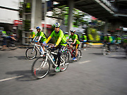 21 SEPTEMBER 2014 - BANGKOK, THAILAND: Bicyclists ride their bikes down Silom Road in Bangkok. The Thai capital hosted Car Free Day 2014 Sunday. Silom Road, the major thoroughfare in Bangkok's financial district, was closed to cars so bicyclists could use the road. The event was to promote the use of mass transit and environmentally friendly means of transportation. About 20,000 people were expected to participate in a city wide bike riding rally.   PHOTO BY JACK KURTZ