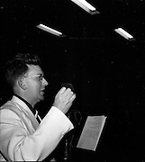 """15/02/1953<br /> 02/15/1953<br /> 15 February 1953<br /> Radio Eireann """"Question Time"""" general-knowledge quiz show trial at the Phoenix Hall, Dublin. Compere Eric Boden."""
