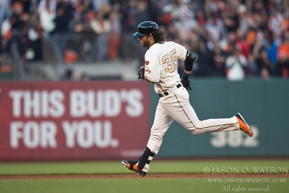 SAN FRANCISCO, CA - APRIL 18:  Brandon Crawford #35 of the San Francisco Giants rounds the bases after hitting a two run home run against the Arizona Diamondbacks during the fourth inning at AT&T Park on April 18, 2015 in San Francisco, California.  The San Francisco Giants defeated the Arizona Diamondbacks 4-1. (Photo by Jason O. Watson/Getty Images) *** Local Caption *** Brandon Crawford