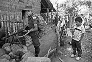 Child guerrilla and child civilian in Perquin, El Salvador.