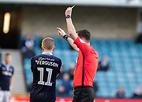 Football - 2018 / 2019 Emirates FA Cup - Sixth Round, Quarter Final : Millwall vs. Brighton<br /> <br /> Referee Christopher Kavanagh shows Shane Ferguson (Millwall FC) the red card during the second period of extra time at The Den.<br /> <br /> COLORSPORT/DANIEL BEARHAM