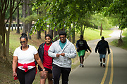 BIRMINGHAM, AL – MAY 8, 2020: People exercise at the Lakeshore Trail in the neighborhood of Homewood. CREDIT: Bob Miller for The New York Times