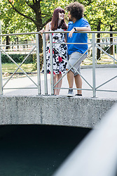 Couple standing together on bridge