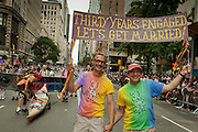 A gay coupe celebrating 30 years together, marching in the 2011 Pride Parade on New York's Fifth Avenue. New York legalized gay marriage less than two days prior to the start of the parade.