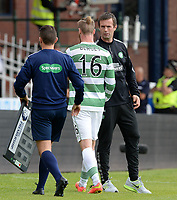 31/09/14 SCOTTISH PREMIERSHIP<br /> DUNDEE v CELTIC <br /> DENS PARK - DUNDEE<br /> Jo Inge Berget (16) passes Celtic manager Ronny Deila after being subbed in the first half