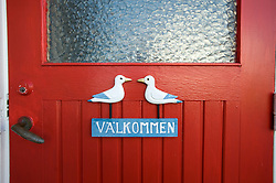 Detail of typical house door n Sweden with word Valkommen or Welcome