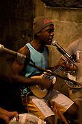 D-Stak lead singer performing at Cota 200 favela, Cubatão