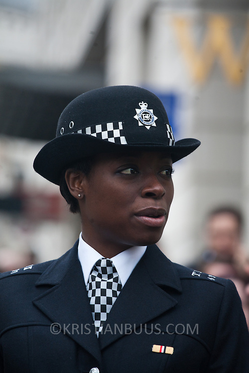 The funeral of former Prime Minister Margaret Thatcher who died Monday April 8.  A black female police officer on duty wearing her best uniform.