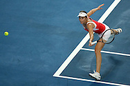 PERTH, AUSTRALIA - JANUARY 07:  Maria Jose Martinez Sanchez of Spain misses a backhand shot to Samantha Stosur of Australia in the Group A match between Australia and Spain during day six of the Hopman Cup at the Burswood Dome on January 7, 2010 in Perth, Australia.  (Photo by Paul Kane/Getty Images)