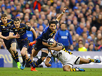 Rugby Union - 2016 / 2017 European Rugby Champions Cup - Quarter-Final: Leinster vs. Wasps<br /> <br /> Leinster's Joey Carbery escapes the tackle from Kurtley Beale of Wasps , at the Aviva Stadium, Dublin.<br /> <br /> COLORSPORT/KEN SUTTON