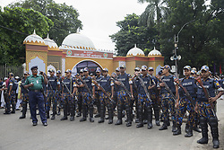 September 2, 2017 - Dhaka, Bangladesh - A group of security guards stand in front of National Eid ground in the Dhaka city. Thousands of people attends for Eid prayer the main Eid prayer ground at National Eidgah in the Dhaka city on 02 September 2017 in Dhaka, Bangladesh. After the prayers, people will slaughter the cattle. Muslims across the world celebrate the annual festival of Eid al-Adha, or the Festival of Sacrifice. (Credit Image: © Monirul Alam/NurPhoto via ZUMA Press)