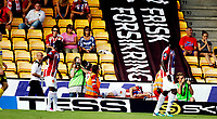 Fotball<br /> Tippeligaen<br /> Åråsen Stadion 03.08.11<br /> Lillestrøm LSK - Tromsø TIL<br /> Hans Norby bæres ut fra Åråsen under reklame for Frisk Forsikring<br /> Foto: Eirik Førde