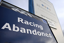 A view of a sign at Huntingdon Racecourse after today's racing was abandoned. An outbreak of equine flu has forced the cancellation of all British racing on Thursday.
