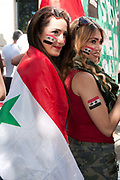 Demonstration against any intervention in Syria called by Stop the War and CND, August 30th 2013, Central London. Young Syrian women with flags painted on their cheeksand one wrapped in a flag.
