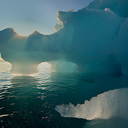 A large iceberg in the waters around Svalbard, Norway.