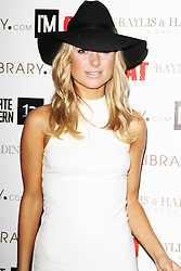 © Licensed to London News Pictures. 17/10/2013, UK. Kimberley Garner, Tyler Shields: Submerged - Private View, Intimate Modern, London UK, 17 October 2013 . Photo credit : Brett D. Cove/Piqtured/LNP