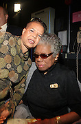 29 October 2010- Harlem, New York- Ntozake Shange, Playwright amd Poet, and Dr. Maya Angelou backstage at The Acquisition of the Maya Angelou Collection of Personal Papers and Materials Documenting 40 years of the Writer's Literary Career held at the Schomburg Center on October 29, 2010 in Harlem, USA. Photo Credit: Terrence Jennings